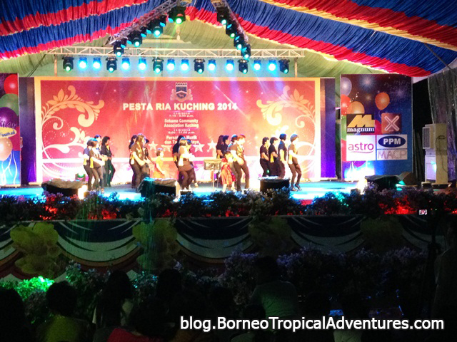 A group of local people dancing in stage